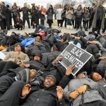 "Baltimore, MD-12/14/14 - More than 500 protesters marched from Empowerment Temple Church on Primrose Avenue north on Reisterstown Road to Reisterstown Road Plaza for ""Black Lives Matter Sunday."" On Reisterstown Road, near the entrance to the shopping center, the protesters formed a circle and many laid down to stage a die-in to show solidarity with Michael Brown. Brown, a 18-year old black man, was fatally shot by a white police officer in Ferguson, Missouri. The officer was not indicted, sparking nationwide protests, including this one. Amy Davis / Baltimore Sun   - #7820"